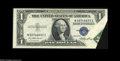 Error Notes:Foldovers, Fr. 1614 $1 1935E Silver Certificate. About Uncirculated. A nicefoldover with the signature and part of the Treasury seal p...