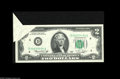 Error Notes:Foldovers, Fr. 1935-D $2 1976 Federal Reserve Note. Choice About Uncirculated.A dramatic $2 foldover error, one of just a handful of i...