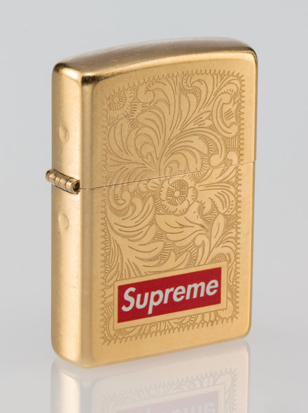 sports shoes 790ab e5e69 Golden zippo lighter  General Americana, Supreme X Zippo. Lighter, c. 2011.