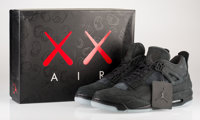 KAWS X Nike Air Jordan 4, 2017 Black sneakers with glow in the dark soles, size 11 6-7/8 x 12 x 3-1/2 inches