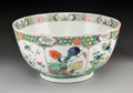 Asian:Chinese, A Chinese Wucai Porcelain Bowl, Qing Dynasty, Kangxi Period, circa1662-1722. 6 inches high x 12 inches diameter (15.2 x 30....