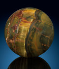 Lapidary Art:Eggs and Spheres, Tiger's-Eye Sphere. Stone Source: Mt. Brockman Station. Pilbara. Western Australia. ...