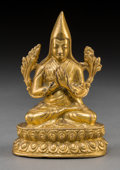 Asian:Other, A Sino-Tibetan Gilt Bronze Figure of a Gelugpa Lama, PossiblyDepicting Tsongkhapa, 17th century. 4-3/8 inches high (11.1 cm...
