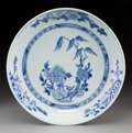 Asian, A Chinese Blue and White Porcelain Dish, Qing Dynasty, KangxiPeriod, circa 1662-1722. 1-3/4 inches high x 10-1/2 inches dia...