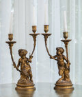 Decorative Arts, French:Lamps & Lighting, A Pair of Louis XVI-Style Gilt Bronze Figural Two-Light Candelabraafter Clodion, late 19th century. Marks: Clodion. 16-...(Total: 2 Items)
