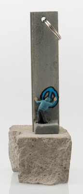 Banksy (b. 1974) Souvenir Wall Section Key Chain, 2017 Painted cast resin, with concrete 5 x 2-
