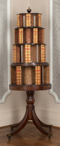 "Furniture , An English Regency-Style Four-Tiered ""Wedding Cake"" Revolving Bookcase Table, 19th century . 69 h x 33-1/2 w x 33-1/2 d inch..."