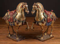 A Large Pair of Chinese Tang-Style Carved, Polychromed, and Partial Gilt Horses, first half 20th century 45-1/2 h