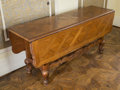 Furniture , A French Provincial-Style Carved Oak Drop Leaf Dining Table, mid-20th century. 30 h x 68 w x 50 d inches (76.2 x 172.7 x 127...