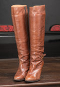 American:Academic, A Zsa Zsa Gabor Pair of Designer Boots, 1970s.. Brown leather,knee-high, 3-inch heel, belt at ankle with a gold-tone buckle...