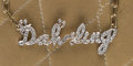 "American:Academic, A Zsa Zsa Gabor Cute Diamond and 14K Gold Necklace, Circa 1970s..Diamonds spell out ""Dah-ling,"" attached to a 14K gold link..."