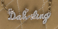 "A Zsa Zsa Gabor Cute Diamond and 14K Gold Necklace, Circa 1970s. Diamonds spell out ""Dah-ling,"" attached to a..."