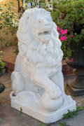 Decorative Arts, Continental, A Pair of Large Cast Stone Lion Entry Figures, mid-20th century. 44h x 17 w x 31 d inches (111.8 x 43.2 x 78.7 cm). ... (Total: 2Items)