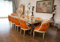 An Eleven-Piece Neoclassical Dining Suite, circa 1960 Comprising mirrored table and ten chairs 29 h