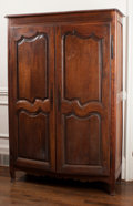 Furniture , A French Provincial Oak Armoire, 18th century. 68-1/4 x 46 x 16-1/2 inches (173.4 x 116.8 x 41.9 cm). Zsa Zsa related in a...