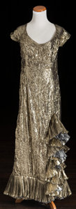 American:Academic, A Zsa Zsa Gabor Evening Gown, 1980s.. Gold and silver crinkle lamé,floor-length, capped sleeves, ruffles at left knee and h...
