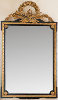 Decorative Arts, French, A Louis XVI-Style Neoclassical Gilt and Ebonized Wood Mirror. 49inches high x 28-1/2 inches wide (124.5 x 72.4 cm). ...
