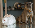 Ceramics & Porcelain, A Terracotta Pug Figure with Porcelain Rabbit, 19th century and later. 12-1/2 inches high (31.8 cm) (pug). 5-3/4 inches high... (Total: 2 Items)