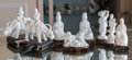 Ceramics & Porcelain, Eight Chinese Blanc de Chine Porcelain Figures on Hardwood Stands. 7-1/2 inches high (19.1 cm) (tallest, boy with ox, exclud... (Total: 8 Items)