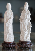 Asian:Chinese, Two Chinese Blanc de Chine Porcelain Guanyin Figures on HardwoodStands. 9-7/8 inches high (25.1 cm) (each, excluding stand)...(Total: 2 Items)