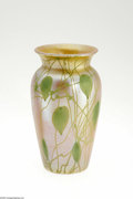 Art Glass:Other , An American Iridescent Glass Vase Durand, c.1900 The baluster formvase in an iridescent peach ground overlaid in green ...