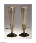 Glass, A Pair Of American Art Glass and Metal Lamps. Durand, c.1890. The scalloped-edge foot of metal lamp base supports a stem u... (Total: 2 Items Item)