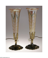 A Pair Of American Art Glass and Metal Lamps Durand, c.1890  The scalloped-edge foot of metal lamp base supports a stem...