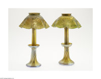 A Pair Of American Glass Lamps Tiffany Studios c.1900  The golden iridescent cushion foot candlestick spiraling to a fla...