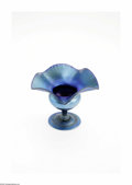 Art Glass:Tiffany , An American Iridescent Glass Compote Tiffany Studios, c.1912 Theiridescent blue Favrile compote with a ruffled rim, the...