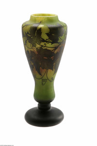 A French Overlaid And Etched Glass Vase Daum Nancy, c.1890  The black cushion foot and knob stem rising to a flared balu...