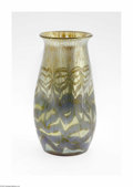 Art Glass:Loetz, An Austrian Iridescent Glass Vase Loetz, c.1900 The tri-pinchedvase with a flared rim in a mottled gold oil spot irides...