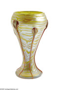 Art Glass:Loetz, An Austrian Iridescent Glass Vase Loetz, c.1900 The baluster formvase in yellow decorated in an iridescent pale blue 'p...