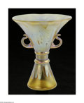 Art Glass:Loetz, An Austrian Art Glass VaseLoetz, ca. 1900 The chalice form vase with two applied handles, two applied bands to the waist ...