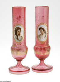 A Pair of Victorian Glass Vases Maker unknown, c.1890  The cranberry glass vases on a raised foot, the body with a cylin...
