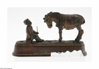 An American 'Always did 'spise a mule' Mechanical Bank J. E. Stevens, c.1897  The rectangular plinth with an African Ame...