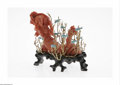 Estate Jewelry:Other , An American Coral Mermaid Balogh, Twentieth century The woodenplatform supports a coral mermaid resting among fourteen...