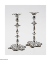 A Pair Of English Silver 'George III' Candlesticks Mark of Ebenezer Coker, London, England, c.1763 & 1770  The match...