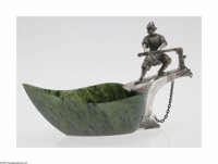 An Imperial Russian Silver And Nephrite Kovash Maker unknown, c.1909  The green and mottled black nephrite boat mounted...