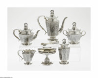 A Russian Silver Tea Service Mark of Antip Ivanovich Kuzmichev, Moscow, Russia, c.1900  The set includes a coffee pot, t...