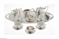 A Continental Tea Set Maker Unknown, c.1900  The tea set includes a large oval tray, ribbed pattern to each end with loo...