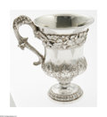 Silver Holloware, Continental:Holloware, An Indian Silver Cup Mark of Calcutta, c.1810 The heavily decoratedpedestal cup with an ornate reeded handle, a pattern...