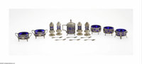 A German Silver and Glass Condiment Set Mark of Germany, c.1880  The set comprising five open salts, four pepper shakers...