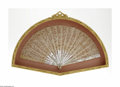 Miscellaneous: , A French Folding Fan Maker unknown, c.Late Nineteenth Century Thesticks of carved ivory in an ornate open filigree, car...