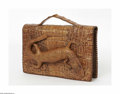 Miscellaneous: , An Alligator Bag Maker unknown, Twentieth Century The brownalligator clutch bag with a baby alligator to the front flap...