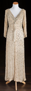 American:Academic, A Zsa Zsa Gabor Evening Gown, Circa 1980s.. Ivory-colored silk,floor-length, three-quarter-length sleeves, v-neck and back,...