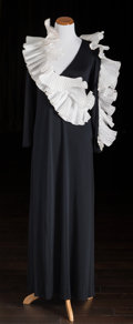 American:Academic, A Zsa Zsa Gabor Evening Gown, 1980s.. Black silk jersey knit,floor-length, long sleeves, v-neck, white silk pleated ruffles...