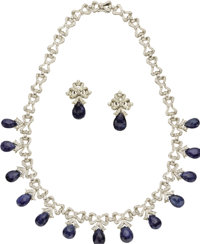 Sapphire, Diamond, White Gold Jewelry Suite  The suite, designed with a ribbon motif, includes: one necklace featuring b...