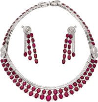 Ruby, Diamond, White Gold Jewelry Suite  The suite includes: one necklace featuring oval-shaped rubies weighing a total...
