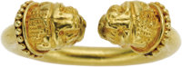 Gold Ring, Greek  The 22k yellow gold ring features opposing lion heads. Made in Greece. Gross weight 8.10 grams. *Note:...