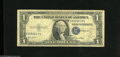 Error Notes:Skewed Reverse Printing, Fr. 1614 $1 1935E Silver Certificate. Very Good-Fine. This noteexhibits multiple errors with an obverse skew to the left a...